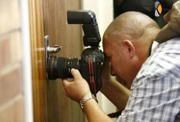 foto maken door sleutelgat
